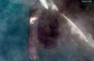A bulk carrier ship, MV Wakashio, that recently ran aground off the southeast coast of Mauritius has been spilling oil into the sea, as seen in satellite images captured by Maxar Technologies on Aug. 7, 2020.