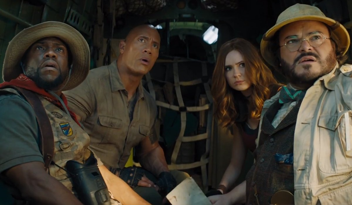 Jumanji: The Next Level the game avatars looking out of a cargo plane