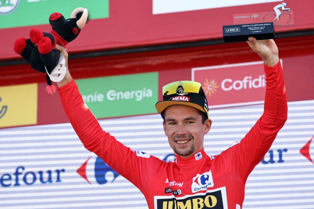Team Jumbos Slovenian rider Primoz Roglic celebrates on the podium wearing the overall leaders red jersey after the 6th stage of the 2021 La Vuelta cycling tour of Spain a 1583 km race from Requena to Cullera on August 19 2021 Photo by JOSE JORDAN AFP Photo by JOSE JORDANAFP via Getty Images