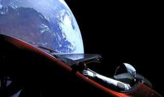 A camera shows SpaceX's Starman mannequin and Elon Musk's Tesla Roadster as they fly above a ROUND Earth after launching on the first Falcon Heavy rocket test flight on Feb. 6, 2018.
