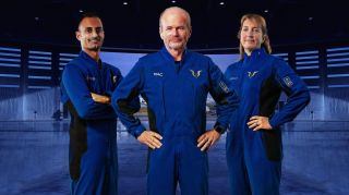 Virgin Galactic pilots Jameel Janjua (left), Dave Mackay (center) and Kelly Latimer (right) model their spacesuits, which were unveiled on Dec. 4, 2020.