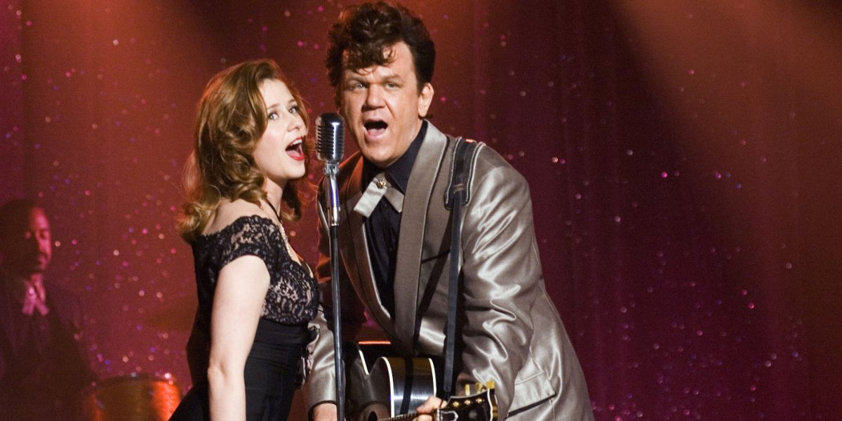 Walk Hard: The Dewey Cox Story Jenna Fischer and John C. Reilly singing at a show