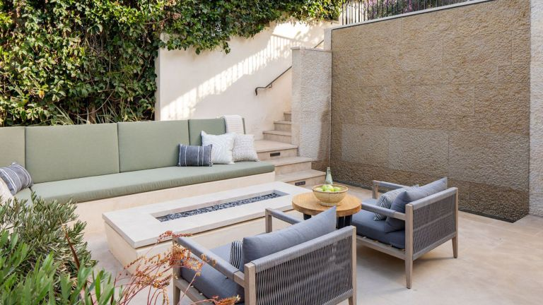 small backyard ideas with sofas and gas fire pit table on patio