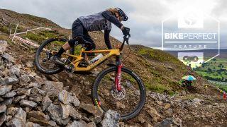 A rider negotiates a technical rocky corner at Ard Rock Enduro 2021