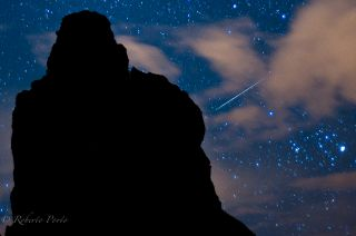 A Quadrantid meteor shower streaks across the night sky over Tenerife in Spain's Canary Islands in this 2012 photo captured by photographer Roberto Porto. The 2015 Quadrantid meteor shower will peak on Saturday, Jan. 3.