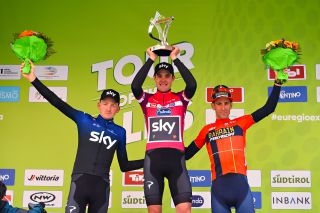 Team Sky's Pavel Sivakov celebrates his overall victory at the 2019 Tour of the Alps from teammate Tao Geoghegan Hart and Bahrain-Merida's Vincenzo Nibali