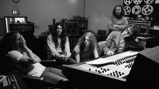 Lynyrd Skynyrd members Ronnie Van Zant, Gary Rossington and Allen Collins work with producer Al Kooper on (Pronounced Lynyrd Skynyrd) with an engineer looking on