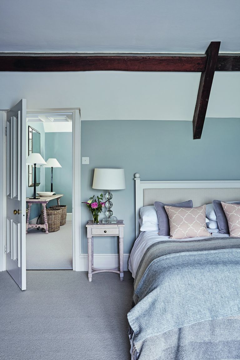 neutral bedroom with side table and bedside lamp