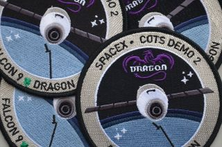 SpaceX embroidered mission patches like those packed aboard their first attempt at flying the company's Dragon capsule to the International Space Station.