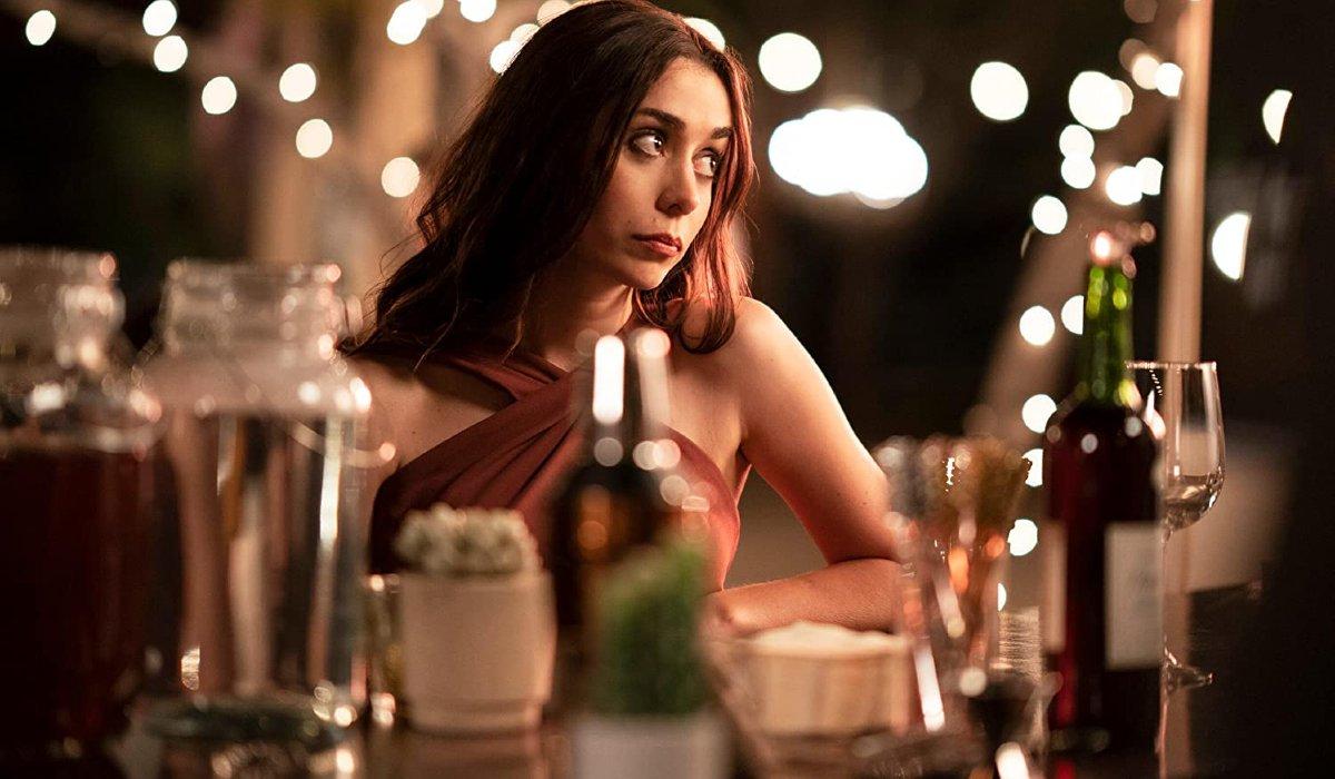 Palm Springs Sarah sits at the bar, bored
