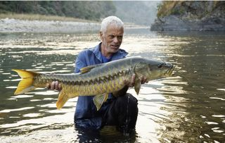 Jeremy Wade with a Mahseer