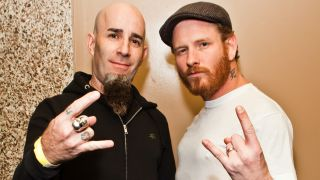 Musicians Scott Ian (L) and Corey Taylor (R) pose backstage at the All Star Concert benefiting Drop In The Bucket at Avalon on November 30, 2011 in Hollywood, California.