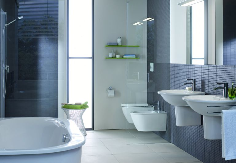 freestanding bathroom sink with unit and on wall taps