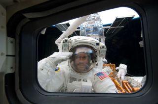 Spacewalkers Tackle Daunting Hubble Telescope Repair