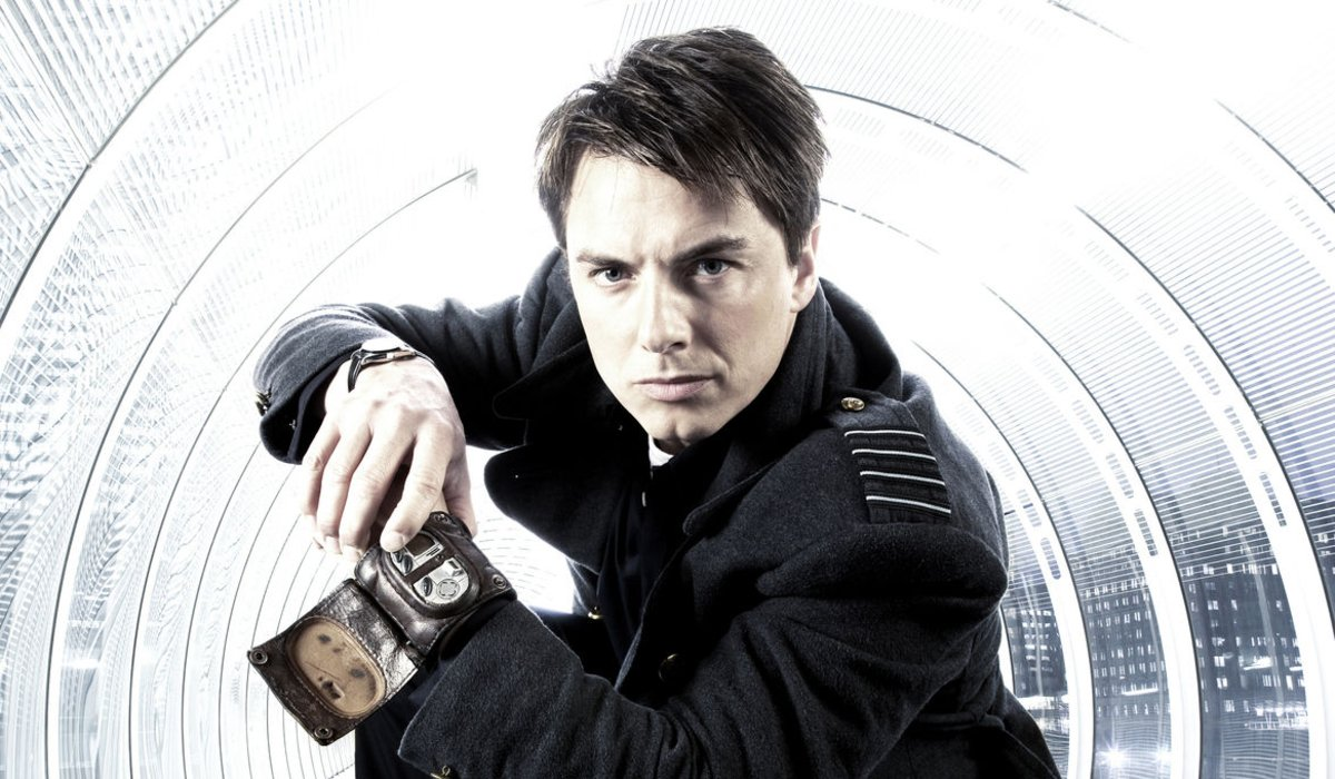 Torchwood Captain Jack Harkness poses with his time vortex manipulator