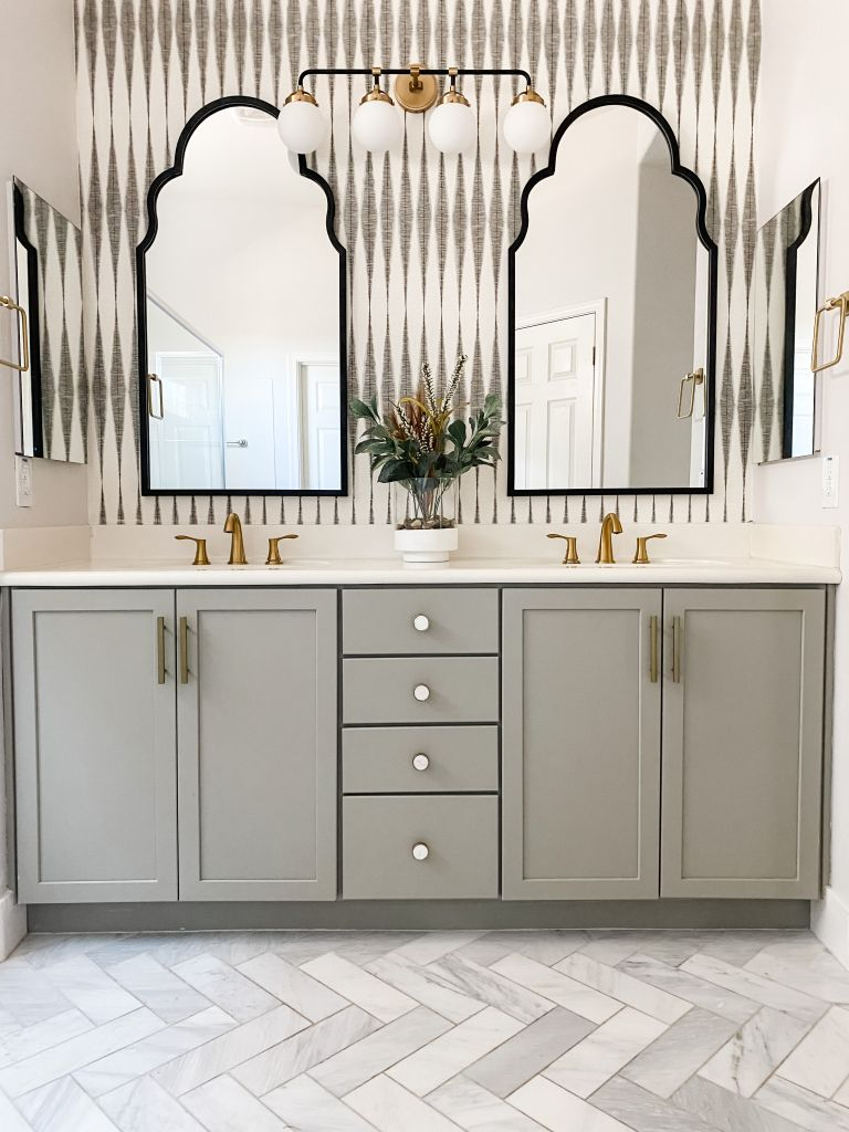 updated bathroom with wallpaper and gray vanity brooke waite