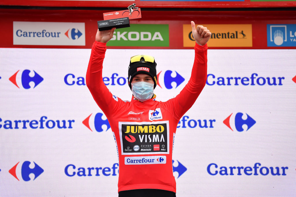 OURENSE SPAIN NOVEMBER 04 Podium Primoz Roglic of Slovenia and Team Jumbo Visma Red Leader Jersey Celebration Trophy Mask Covid safety measures during the 75th Tour of Spain 2020 Stage 14 a 2047km stage from Lugo to Ourense lavuelta LaVuelta20 La Vuelta on November 04 2020 in Ourense Spain Photo by Justin SetterfieldGetty Images