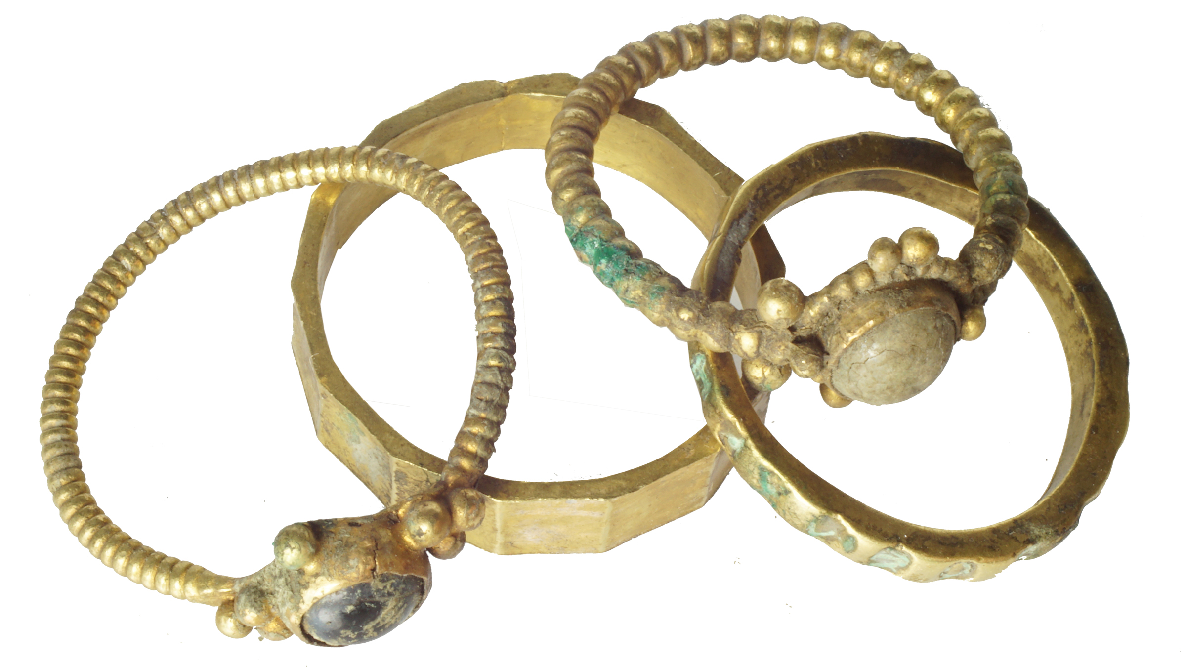 The four gold rings found in the medieval hoard.