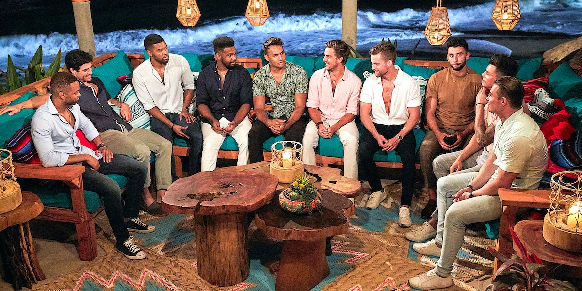 Bachelor in Paradise Season 7 men talk while Brendan Morais looks shifty.