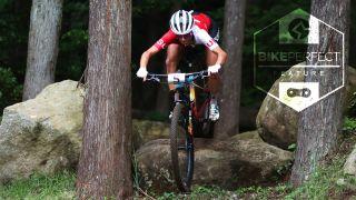 Jolanda Neff (Switzerland) jumps a technical rock feature