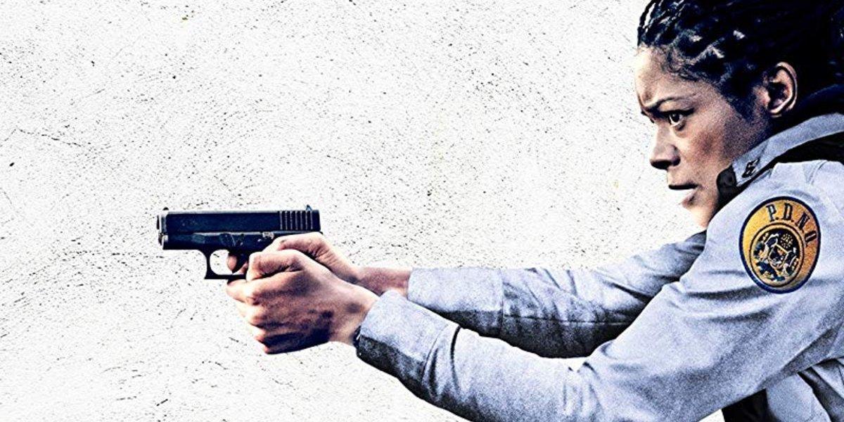 Black and Blue Naomie Harris with gun drawn