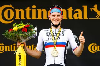Matej Mohoric on the podium after winning stage 7 of the 2021 Tour de France
