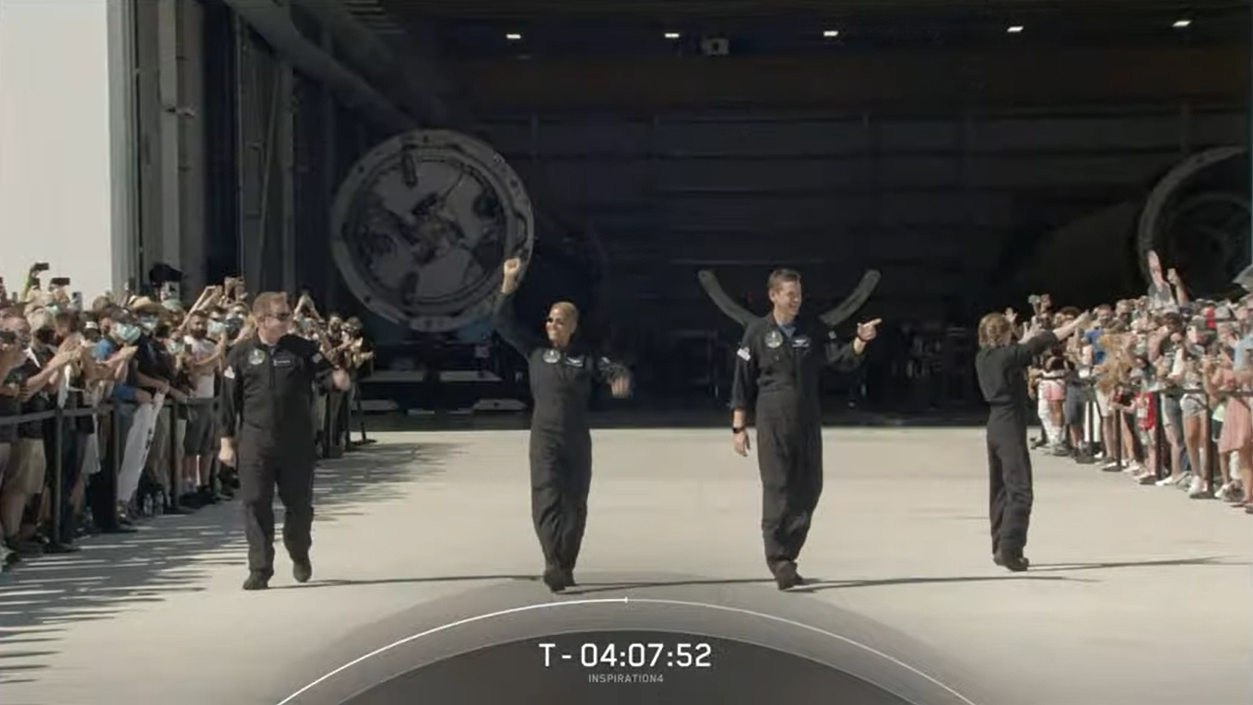 SpaceX's first all-civilian crew for the Inspiration4 mission walks out of Hangar X at Cape Canaveral Space Force Station to head to their launch pad on Sept. 15, 2021.