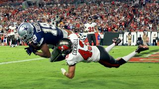 Amari Cooper #19 of the Dallas Cowboys catches a touchdown pass against Ross Cockrell #43 of the Tampa Bay Buccaneers during the third quarter at Raymond James Stadium on Sept. 9, 2021 in Tampa, Florida.