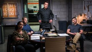 FBI: Most Wanted cast sitting at table cbs