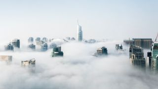Cloud POS symbolized by view of cityscape buried in clouds