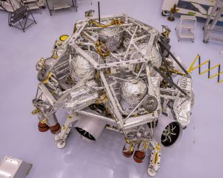 This image of the rocket-powered descent stage sitting on top of NASA's Perseverance rover was taken in a clean room at Kennedy Space Center on April 29, 2020. The integration of the two spacecraft was the first step in stacking the mission's major components into the configuration they will be in while sitting atop of the Atlas V rocket.