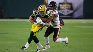 Robert Tonyan #85 of the Green Bay Packers runs with the ball while being tackled by Buster Skrine #24 of the Chicago Bears in the first quarter at Lambeau Field on Nov. 29, 2020 in Green Bay, Wisconsin.