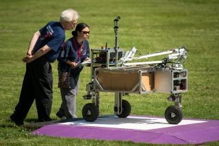 NASA 2013 Sample Return Robot Challenge organizers monitor the Wunderkammer team robot during level one of the challenge at Institute Park, Wednesday, June 5, 2013 at the Worcester Polytechnic Institute (WPI) in Worcester, Mass. The annual contest awards