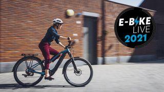 Woman riding a Shimano ebike in an urban environment