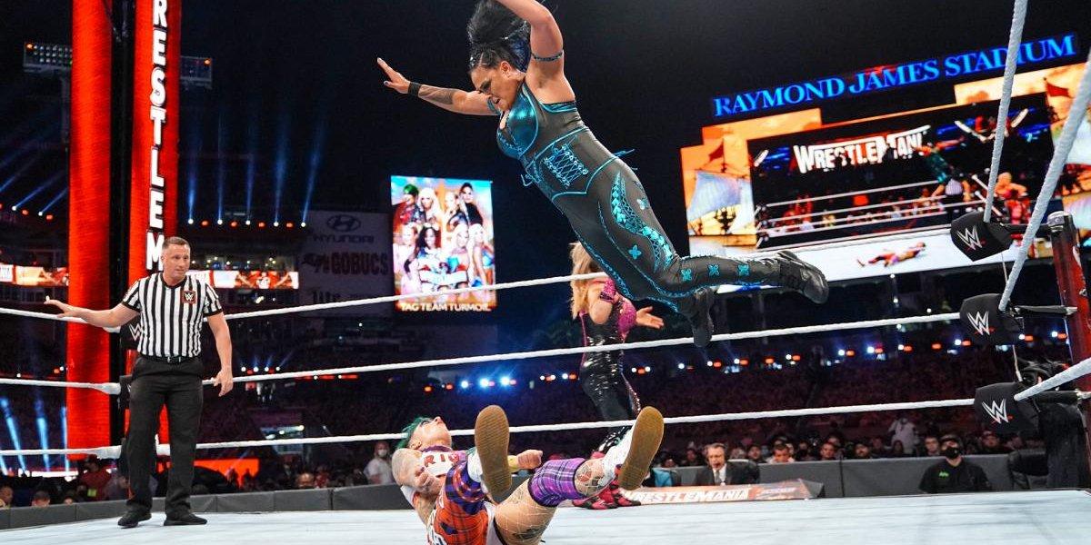 Tamina performing the Superfly Splash onto Ruby Riott at WrestleMania 37