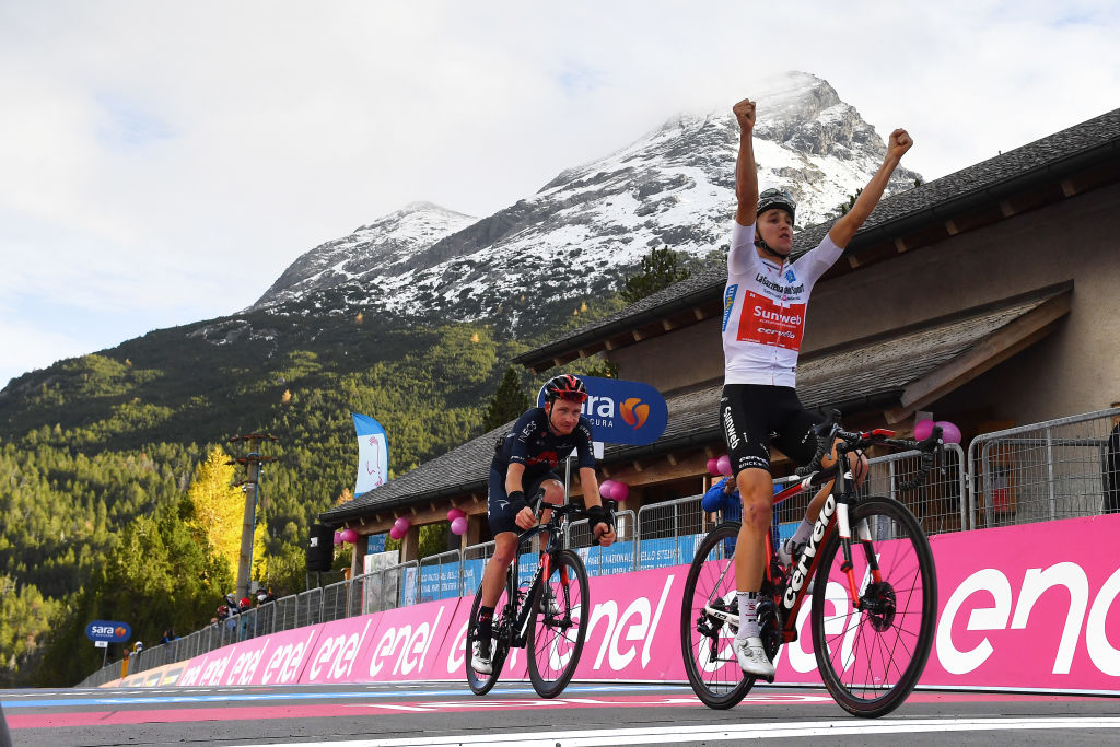 LAGHI DI CANCANO ITALY OCTOBER 22 Arrival Jai Hindley of Australia and Team Sunweb White Best Young Rider Jersey Celebration Tao Geoghegan Hart of The United Kingdom and Team INEOS Grenadiers during the 103rd Giro dItalia 2020 Stage 18 a 207km stage from Pinzolo to Laghi di Cancano Parco Nazionale dello Stelvio 1945m girodiitalia Giro on October 22 2020 in Laghi di Cancano Italy Photo by Stuart FranklinGetty Images
