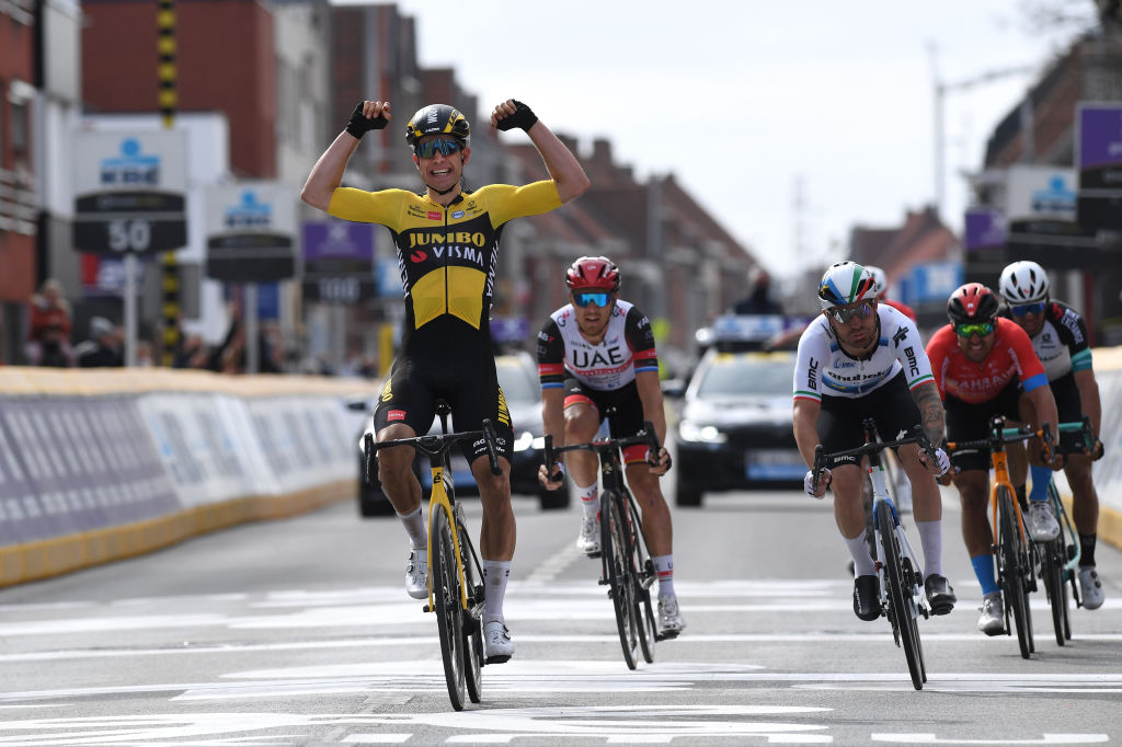 WEVELGEM BELGIUM MARCH 28 Arrival Wout Van Aert of Belgium and Team Jumbo Visma Celebration Giacomo Nizzolo of Italy and Team Qhubeka Assos Matteo Trentin of Italy and UAE Team Emirates Sonny Colbrelli of Italy and Team Bahrain Victorious Michael Matthews of Australia and Team Team BikeExchange during the 83rd GentWevelgem in Flanders Fields 2021 Mens Elite a 254km race from Ypres to Wevelgem GWE21 GWEmen FlandersClassic on March 28 2021 in Wevelgem Belgium Photo by Tim de WaeleGetty Images