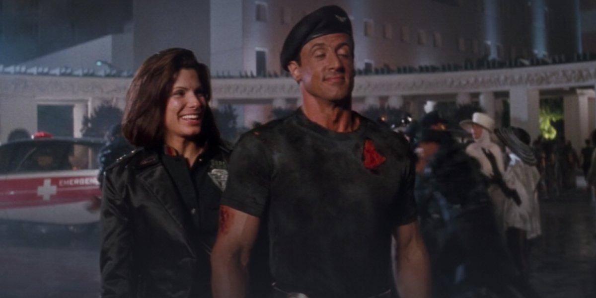 Sandra Bullock and Sylvester Stallone in Demolition Man