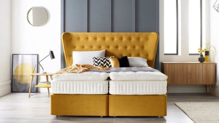 bedroom with grey panelling and yellow bed by harrison spinks