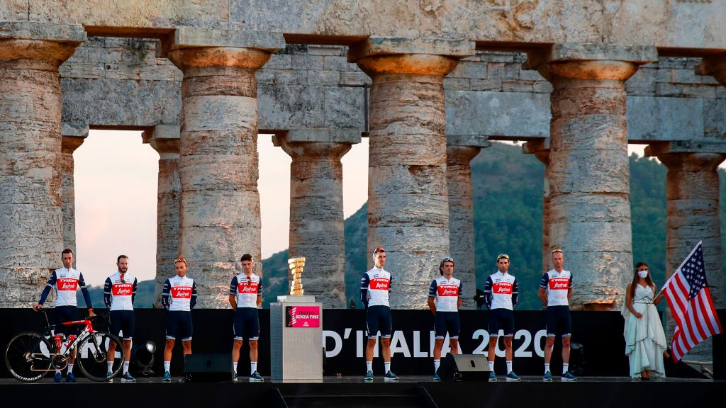 Team Trek Segafredo rider Italys Vincenzo Nibali L and teammates pose on stage at the Doric Temple of Segesta near Palermo Sicily on October 1 2020 during an opening ceremony of presentation of participating teams and riders two days ahead of the departure of the Giro dItalia 2020 cycling race Photo by Luca Bettini AFP Photo by LUCA BETTINIAFP via Getty Images