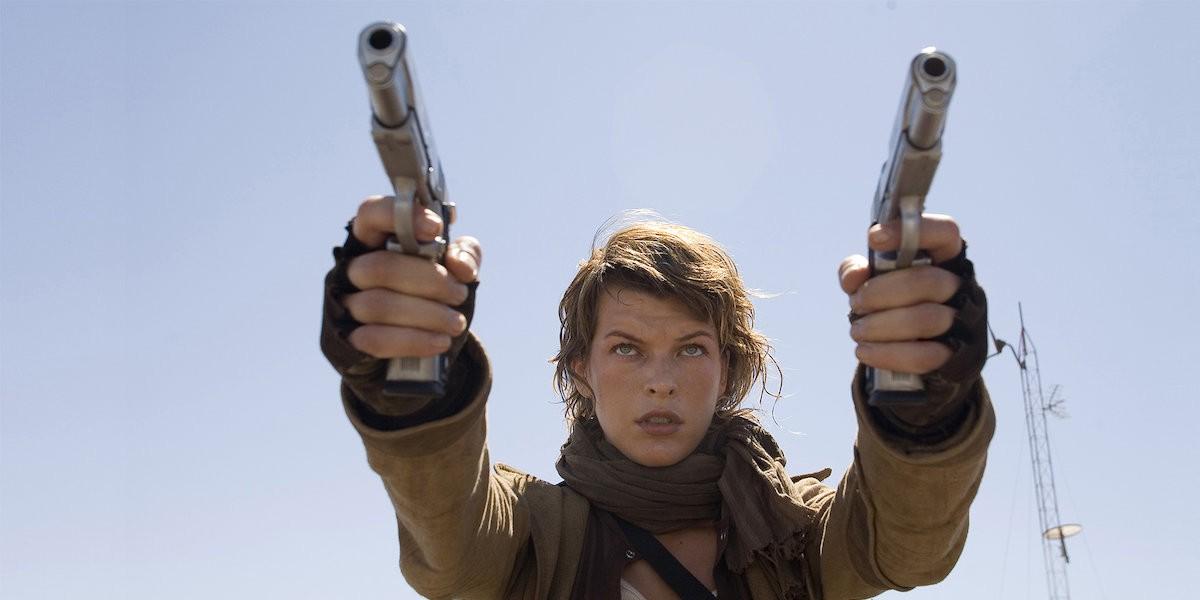 Milla Jovovich dual-weilding guns
