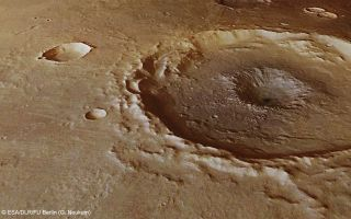 Crater in Thaumasia Planum space wallpaper