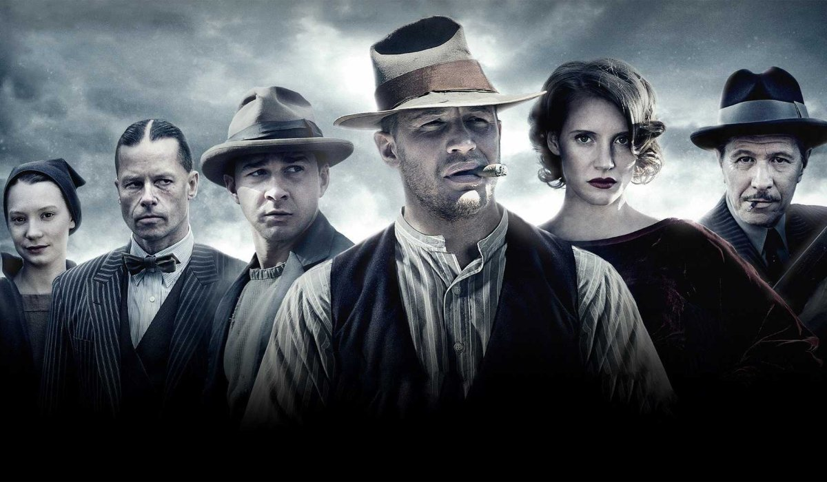 Lawless cast lined up in front of a cloudy background