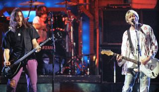 (from left) Krist Novoselic, Dave Grohl and Kurt Cobain perform at the Pauley Pavilion in Los Angeles in 1992
