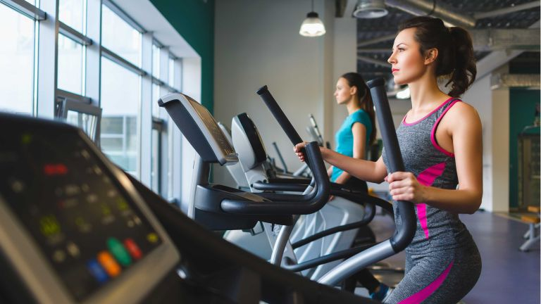 Best cross trainers: woman in gym using cross trainer