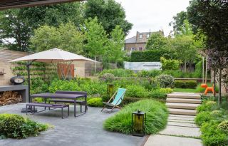 a modern space with lots of sloping garden ideas