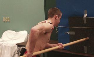 A volunteer pretending to be a Neanderthal.