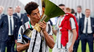 Cristiano Ronaldo kisses the Serie A trophy after Juventus won the 2020 Italian League season.