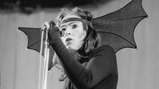 Peter Gabriel performing in costume with rock group Genesis, Newcastle City Hall, 1st October 1972