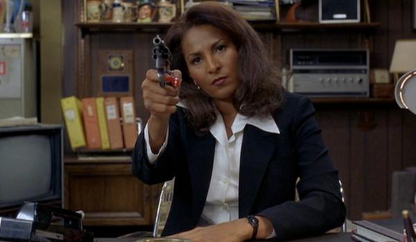 Jackie Brown holding a Gun